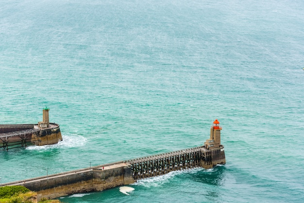 View of an old pier with lighthouse