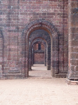 View of the old stone arches of the chapel going into the distance. architecture of old buildings