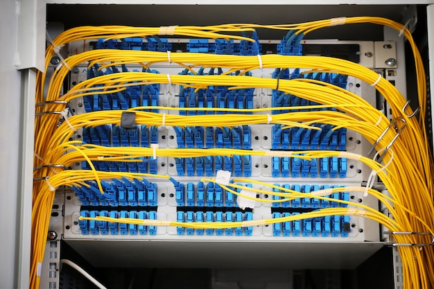 View of open cabinet with wires in server room, closeup