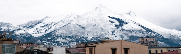 View of palermo with snowy mountain. mount cuccio