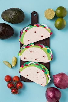 Above view paper tacos on wooden board