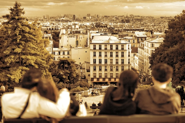 View of paris from the hill of montmartre.couples in love.paris. france