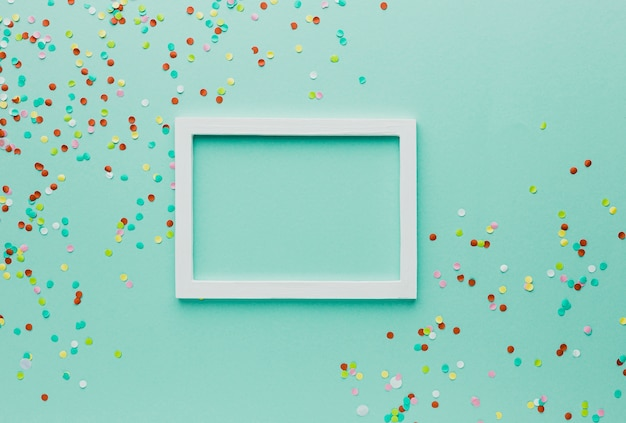 Above view party decoration with frame and green background