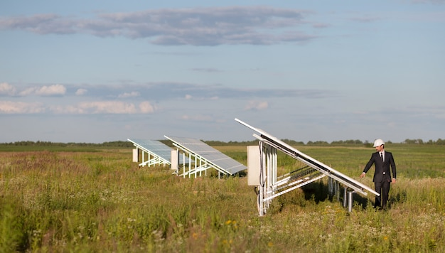 View on photovoltaic panels of solar power station in the field.