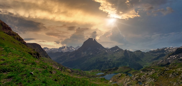 View of pic du midi ossau and ayous lake in the french pyrenees mountains
