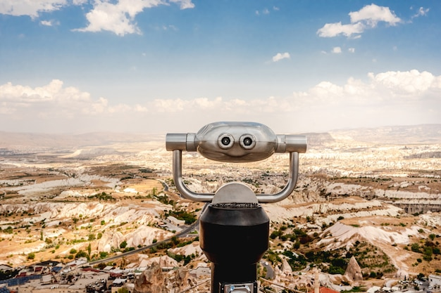 View point with binoculars above turkish landscape in cappadocia, turkey