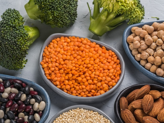 Above view of red lentils and other vagan protein sources on gray concrete background close up top view or flat lay copy space