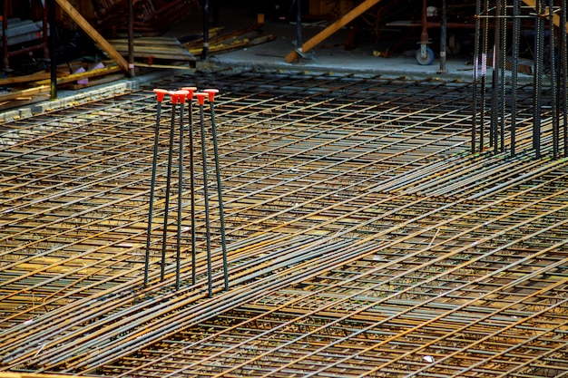 View of reinforcement of concrete with metal rods connected by wire. preparation for pouring