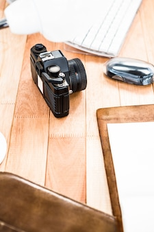 View of retro camera on wooden desk