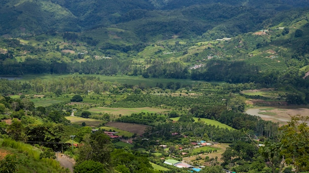 View of rural area with hill and mountain in costa rica