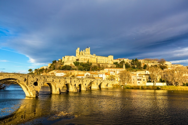 View of the saint nazaire cathedral and the pont vieux bridge in beziers