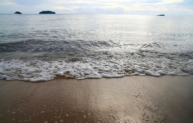 View of sand beach and sea water wave in evening , koh chang island