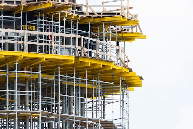 View of scaffolding and structural reinforcement during the construction of a round building.