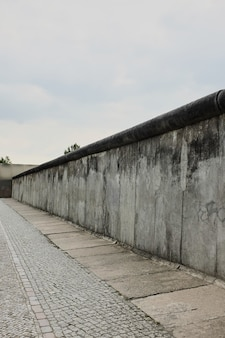 View of a section of the original east-west berlin wall, part of the berlin wall memorial