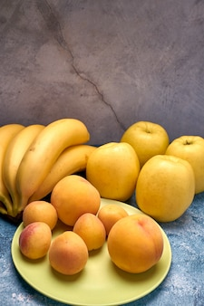 View of several ripe yellow and orange fruits