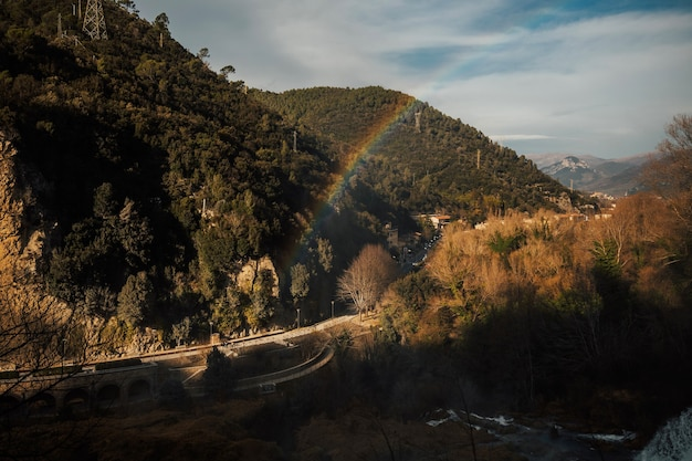 View showing crescent shaped rainbow produced by the spray from upper waterfalls at marmore, umbria,