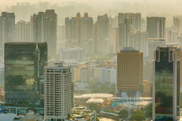 View of singapore city at misty sunset