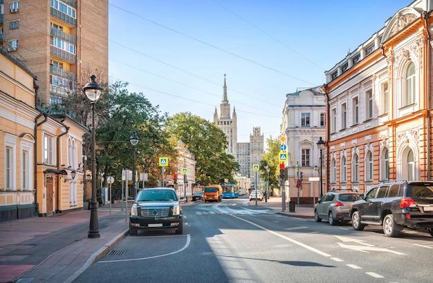 View of the skyscraper on kudrinskaya square from bolshaya nikitskaya street in moscow on a sunny summer day