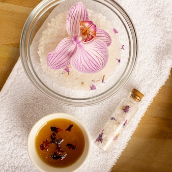 Above view spa concept with flower in a bowl