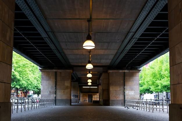 View of the space under the bridge in the city.