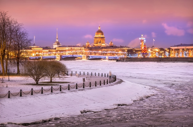 View of st. isaac's cathedral, palace bridge, rostral column on the strelka in st. petersburg