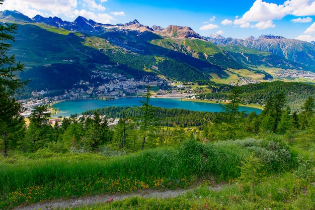 View of st. moritz from a mountain trail in summer