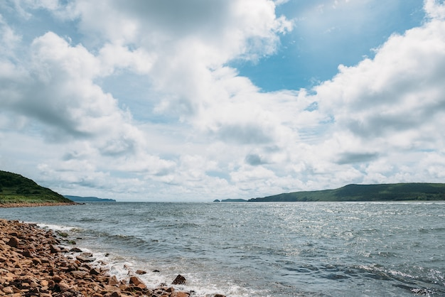 View of stark strait in autumn, sea and sky with clouds. travel and nature theme.