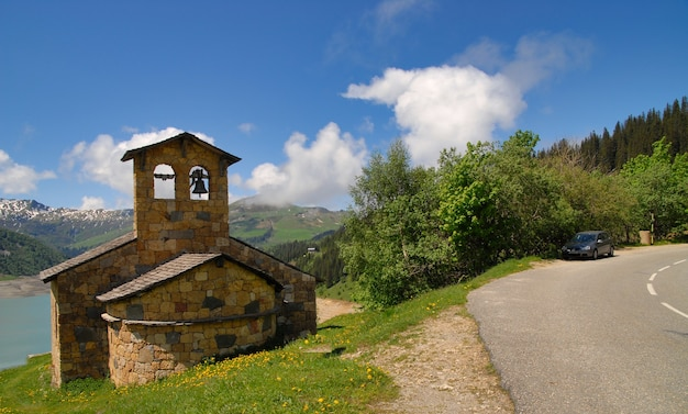View of stone chapel on roselend lake france