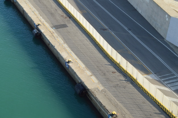 View of the stone and concrete breakwaters along the pier, the port of civitavecchia