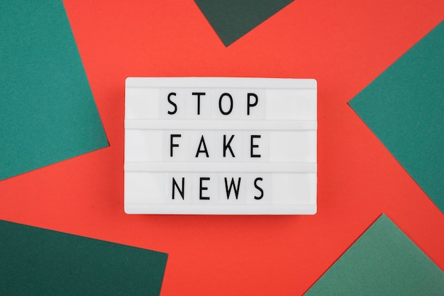 Above view stop fake news concept