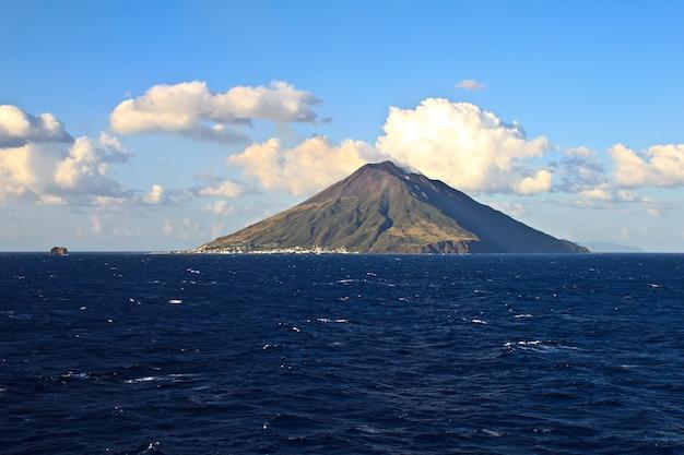 View of the stromboli volcano over the sea