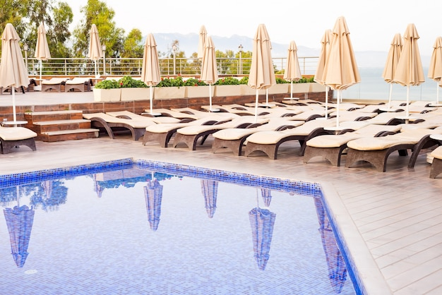 View on a swimming pool and blue water at the resort with beautiful sea view