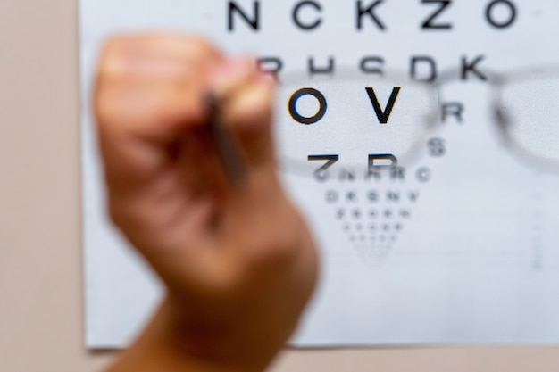 View through glasses vision test table, eye chart