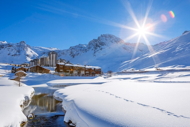 View of tignes village with sun, france.
