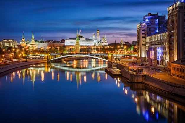 View of the towers, temples of the moscow kremlin and the big stone bridge