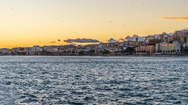 View of the town of villajoyosa from its fishing port at sunset, alicante, spain.