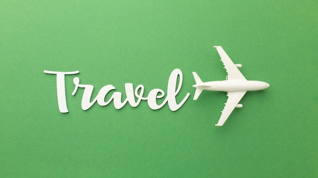 Above view travel items on green background