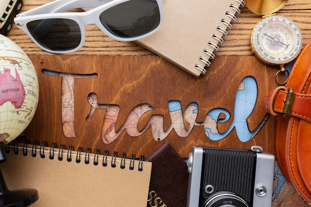 Above view traveling items on wooden background
