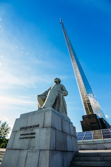 View of tsiolkovsky monument with a rocket in the sky. russia, moscow