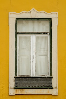 View of a typical european window of a building in the city.