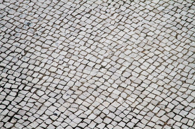 View of typical portuguese urban cobblestone background texture.