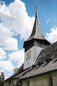 View on upper part of old time church in switzerland