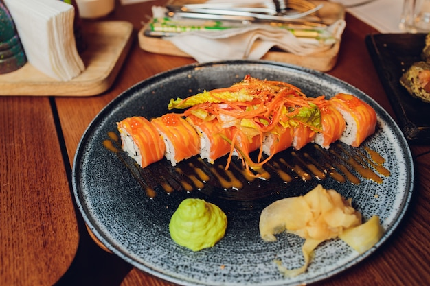 Above view of various sushi and rolls placed on wooden board