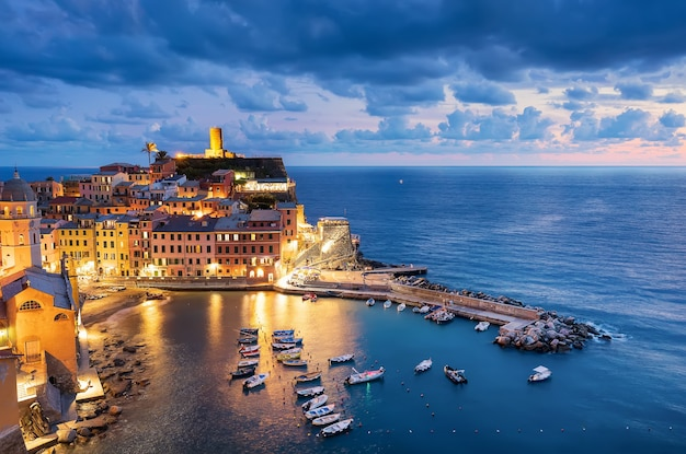 View of vernazza pier and boats at night cinque terra italy europe
