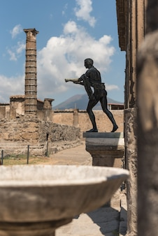 View of the volcano vesuvius from the temple of apollo at the roman archaeological site of pompeii, in italy.