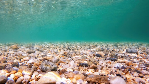 View under the water of the aegean sea, transparent blue water, rocky bottom