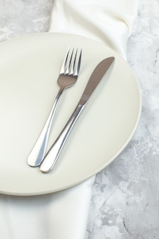 Above view white plate with fork and knife on light background kitchen glass ladies femininity food colour meal horizontal