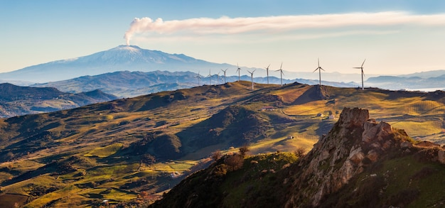 View of windmills and the mount etna volcano