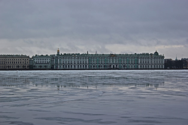 View of the winter palace in winter from the side of neva river