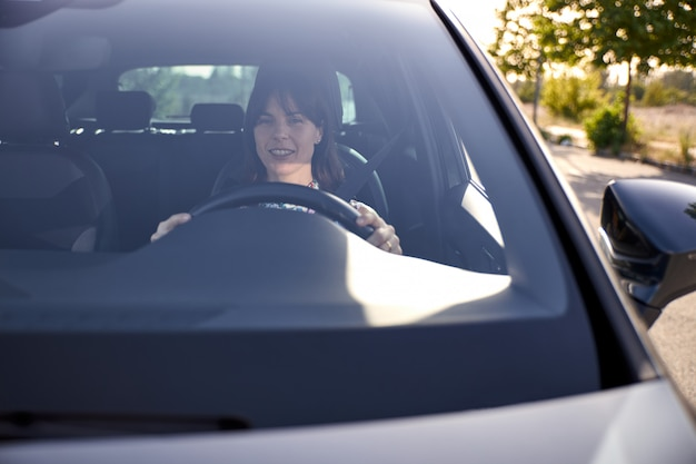 View of a woman driving her car